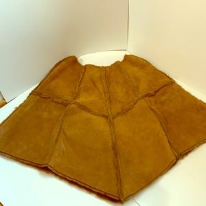 Suede poncho with pockets with pockets